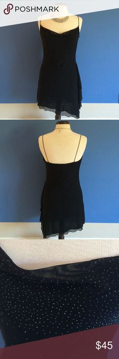 """New ListingBlack Evening Dress Walk into a room and be noticed!  The chest portion dips down slightly to be sexy but classy.  The top front of the dress has sparkles sprinkles throughout that move slightly to the waistline. The left side of the dress has a hi - lo effect which really draws your eye.  Material:  80% Nylon/20% Spandex.  Measurements:  Length - 33"""" (left side goes to 38"""")/Bust - 18""""/Waist - 15"""" Guess Dresses Asymmetrical"""