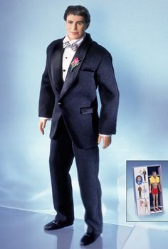 40th Anniversary Ken Doll. Anniversary Dolls. Collector Edition Designed by: Sharon Zuckerman Release Date: 6/1/2001 Commemorating Ken® doll's 40th anniversary, Ken wears a smart tuxedo.  Ken is dressed for the occasion, in an elegant black tuxedo, complete with a white satin shawl collar and pink boutonniere. Ken also comes with a boxed mini replica of the very first Ken doll wearing his red bathing suit and yellow towel, circa 1961.