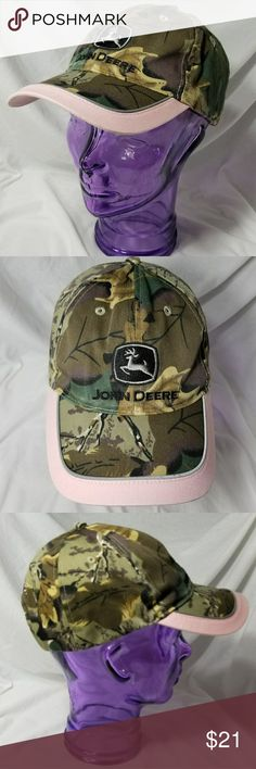 JOHN DEERE  Brown Camouflage & Pink Ball Cap Brand:  John Deere  Item: *Brown & Green Camo Print All Over the Hat *There is a Line of Soft Pink Across the Bill, Under the Bill & a Band to Keep it on Your Head *Snapback so you Can Adjust the Fit *'Deere Season' is Embroidered Above Snapback Section *65% Polyester, 35% Cotton *Excellent, Pre-Loved Condition  *no trades, offers via offer button only* John Deere Accessories Hats