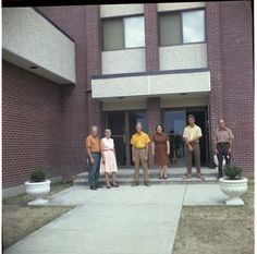 Watchtower Farms D building @1971 left to right - dad (Jim), mom (Irene), me (Roger), the Drummonds - Francis, John (my roommate in the plywood jungle, he was one of 70 single brothers called in for construction), Harold, who were from our home congregation Council Bluffs, IA West Unit (Roger Johnson)