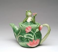 For those who want a bit of whimsy in their home decor, this is the perfect accessory.  An adorable frog is happy as can be on his lilypad teapot decorated with raised pink flowers on a leafy green background. This teapot is made of ceramic and is fully functional.  8 3/4