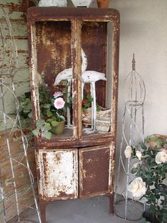 Described as a doctor's cabinet from the 1800's.  I love this.  Left alone in its rustyness, used outdoors.
