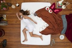 Girl's Dreams Creatively Displayed in Bed by photographer Jan von Holleben