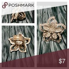 cool Wet Seal Fashion Ring Doesn't photo well but flower is very pretty. Worn man...