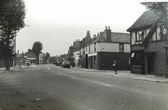Newmarket Road 1960ish, The Corner House Pub on the right at the top of River Lane, the Pheonix fish & chip shop on the other corner, and the old Fire and Ambulance Station on the left just beyond the Coldhams Lane junction, and The Bell Pub two doors further up with the hanging sign.. Cambridge Pubs, Honeymoon Night, Corner House, Hanging Signs, Ambulance, Norfolk, Old Photos, Past, Old Things