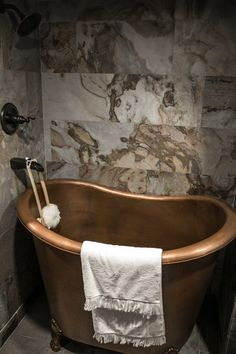 Another shot of the Tudor-style tiny house's copper clawfoot bathtub