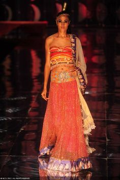A model displays a creation by designer Rina Dhaka on Day 2 of India Bridal Fashion Week in New Delhi on July 24, 2013
