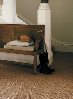 Coir Herringbone carpet and muted natural tones. Could use long pew as bookshelf too