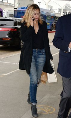 Celebrity airport style - jeans with a tee tucked in ankle boots and a cardigan