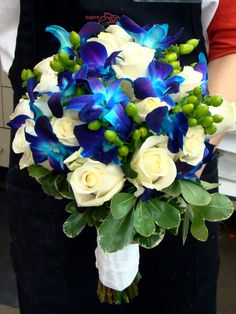 This bouquet of blue orchids and white roses is EXACTLY what I want. The pop of green is so fashionable! #projectdressme