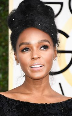 Janelle Monae from 2017 Golden Globes' Best Beauty Looks  The singer's bronzed lids and pink lips felt fresh, but formal.