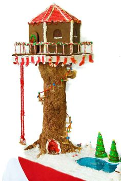 Gingerbread Tree house! i love the Pez bricks and the chewing gum shingles!