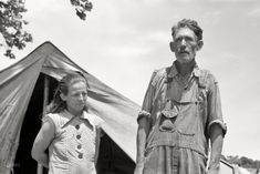 """June 1939. Another look at the fellow we saw here last week, this time with some company. """"Veteran migrant worker and his wife camped in Wagoner County, Oklahoma. He has followed the road for about 30 years. When asked where his home was he said, 'It's all over.'"""""""