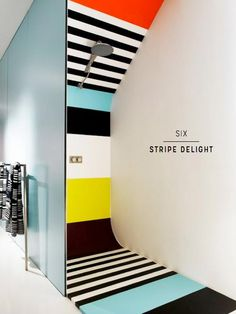 A striped shower to wake you up - Seven Amazingly Colourful Shower Room Ideas