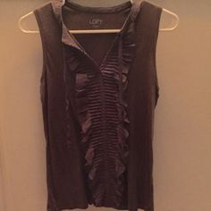 Ann Taylor Loft sleeveless top Taupe colored sleeveless top with beautiful lace ruffle design trailing down middle of shirt. 100% cotton. In like new condition. Ann Taylor Loft Tops Muscle Tees
