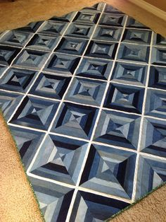 "Denim String Quilt made using 10"" Paper Piecing Squares from MSQC. White denim was cut 1 1/2"" wide. Various blue denims were cut various widths from 1 3/4"" to 2 1/2"". MSQC has a youtube video on how to make a string quilt."