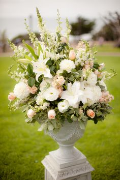 amazing peach and white ceremony floral arrangement