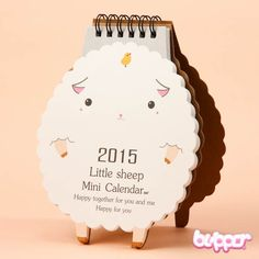 Sheep 2015 Desk Calendar  What a cute way to be up-to-date! This little sheep and her little animal friends follow you through the year 2015. They will keep you on the right date every day, as well the rest of 2014. Her expressions change every month, everything from cute to surprised. Year 2015 is the year of the sheep in the Zodiac calendar. The back side of the calendar is made out of sturdy material, so you can keep it standing on your desk!  I want this for my desk :D