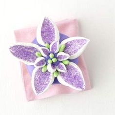 petal cupcakes - lavender colored sugar, marshmallows, good and plenty candies, lavender frosting,