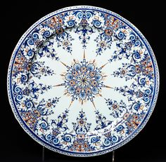 Dish, Rouen, France, 1700-1720. Museum no. 402-1870. Famous for this pottery.Bought a beautiful pottery tile here.