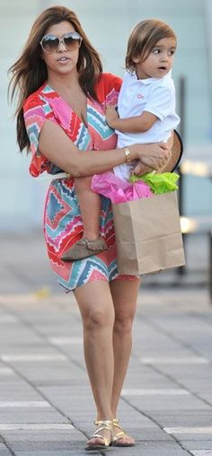 Kourtney Kardashian Pictured Here With (Cutie) Mason Wearing His Moccasins... While Kourtney Is Wearing A Colorful, Aztec, Summer Dress With Gold Gladiator Sandals. Beautiful!