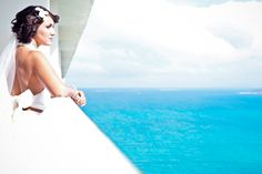 The bride enjoys the stunning view of the Caribbean from her balcony at El Conquistador Resort & Las Casitas Village.  ElConResort.com   destination wedding  - Puerto Rico