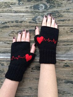 Hand knitted fingerless gloves with red heartbeat pattern. The gloves are made from soft light black yarn. These handknit fingeless gloves are so soft and cozy Fingerless Gloves Knitted, Crochet Gloves, Knit Mittens, Wrist Warmers, Hand Warmers, Crochet Baby, Knit Crochet, Crochet Granny, Crochet Accessories