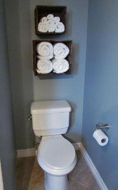 Over toilet storage-why hide pretty rolled towels?