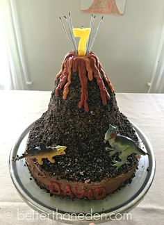 A simple dinosaur volcano cake but with hidden fossils inside!