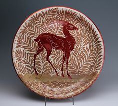 For the table at the country house.ake sure the table is se by a roaring fire.(A large lustre glazed charger decorated by Charles Passenger for William de Morgan (c. Ceramic Pottery, Pottery Art, Ceramic Art, Art Nouveau, English Pottery, Deer Art, Sgraffito, China Painting, Ceramic Design