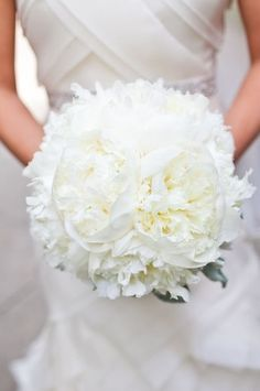 Gorgeous white bridal bouquet with peonies as a focal point