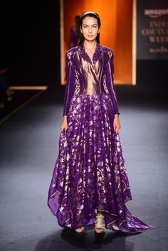 Purple and gold floral asymmetrical jacket dress Shop now: http://www.perniaspopupshop.com/designers/rahul-mishra #shopnow #perniaspopupshop #rahulmishra #aicw #aicw2015 #bridal #lehenga #handmade