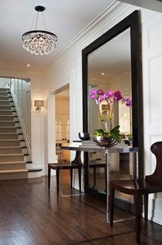 Using a huge mirror in your entry way.