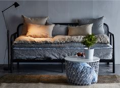 4. YOU DON'T NEED A SOFA BED TO CREATE AN EXTRA SLEEPING SPACE. Layer an extra mattress or two on your day bed (which is another sleeping space in itself) and just move them down to the floor when you've got two or more folks sleeping over. Stash extra blankets and pillows in a basket nearby.