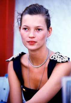 Kate Moss rocking decorative shoulders backstage in the early '90s // #Celebrity #Throwback