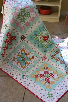 Granny Quilt ... LOVE the way she bordered the Granny Square with aqua ... different touch from so many of the grannies you see