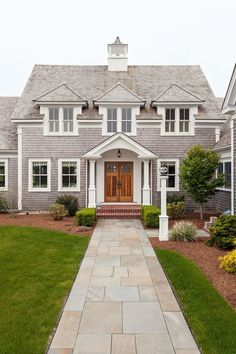Classic cape cod exterior, double doors, stone walkway