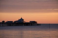 Llandudno pier north Wales UK. By ccrcats. If you like you can buy it at http://fineartamerica.com/featured/llandudno-pier-at-dawn-christopher-rowlands.html?newartwork=true