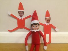 Elf on the shelf. Cinnamon dressing the girls up as elves