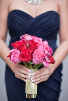 pink and red roses bouquet to go along with navy bridesmaid dresses - perfect combo