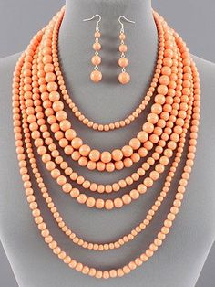This is a MUST see! Multi-layered bead necklace and earring set in one of the hottest colors of the season...CORAL! Also available in mint! $22.99 for the set! www.facebook.com/reallyroxie