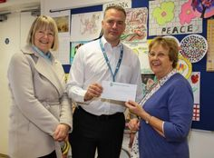 Denise Moores presenting cheque to Chris Neal, representing Community Meeting and Fiona Gaskell (left), chair of Harpenden Seniors Forum