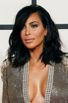 Kim Kardashian arrives at the 57th annual Grammy Awards in Los Angeles