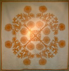 Vintage Hawaiian quilt, made circa 1950.  Design is cut from a single piece of fabric and appliqued to the background.