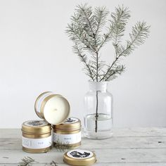 Winter stories... aromatic candles beautifully presented in a brushed gold tin and created using only natural ingredients and scents. #candles #winter #evergreen #christmas #festive #fir #spruce #pine #cedar