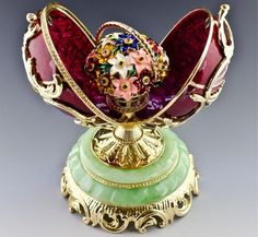 Springflowers Faberge Egg.  This delightful creation made in gold and enamels, opens to reveal a dainty basket of flowers.