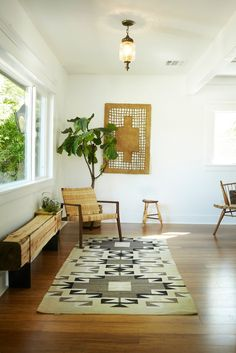 White walls, green plants, wood, and clean lined furniture are all part of the Minimal Bohemian look to me.