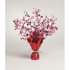 Love is springing up all over and taking center stage on your tables with this cute Valentine's centerpiece. Guests will gaze lovingly at the Foil Hearts Centerpiece Spray decoration. The unique decor