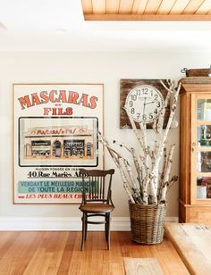 Entryway Inspiration:  birch or aspen in a big basket with bulbs & lights