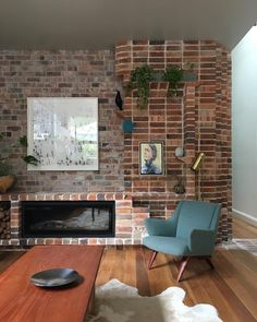 "David Boyle on Instagram: ""Sneak peak of photo shoot today at our #2_semis_camperdown with @simonwhitbreadphoto. Living room wall using #recycled #brick salvaged from demolition, graded and laid in irregular and stack bond. Bricks have been corbelled, cut and chamfered to create shelves and a fluted corner return to the hall. Styling by @vamptvintagedesign Artwork by Joseph Rolella. #livingroom #interiordesign #australianarchitecture #davidboylearchitect"""